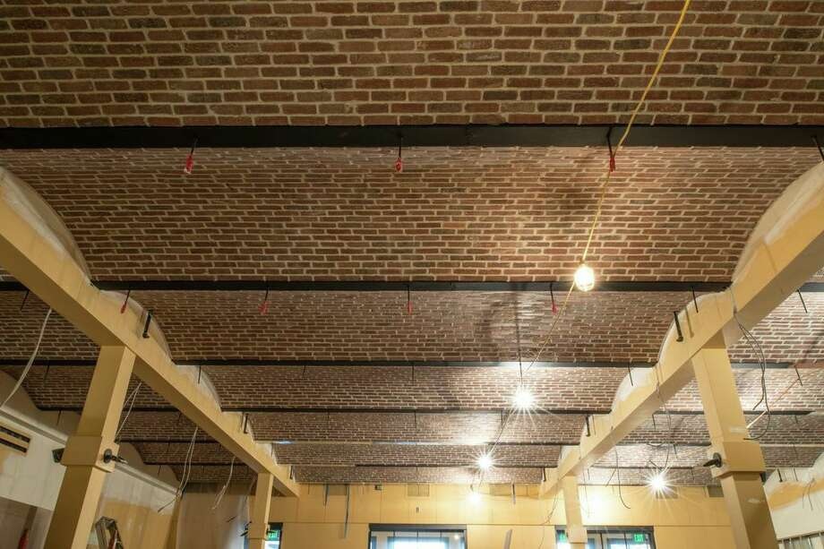 """The original ceiling was this odd, Dutch 70s thing,"" said Dorf. ""It was boring and had bad acoustics."" Now, the ceiling flows in undulating brick."