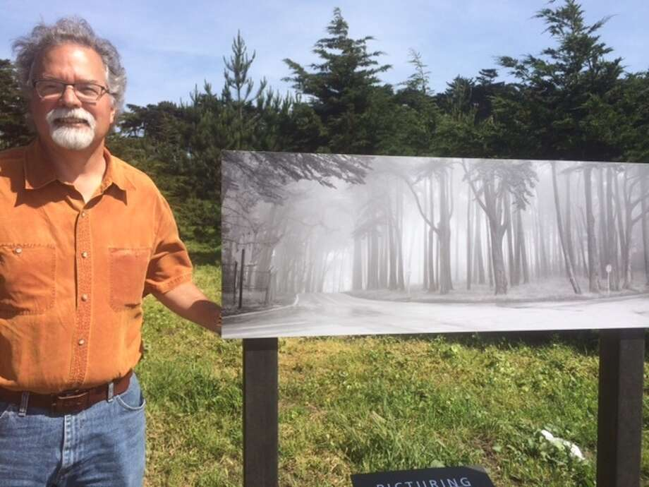 Photographer Lyle Gomes with his image San Francisco Presidio #1 at the location where it was taken in 1989. The Chronicle/Sam Whiting