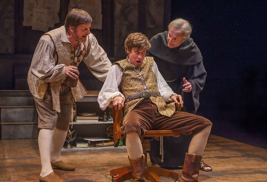 Hamlet (Jeremy Kahn, center) is torn between Faustus (Michael Stevenson, left) and Martin Luther (Dan Hiatt). Photo: David Allen
