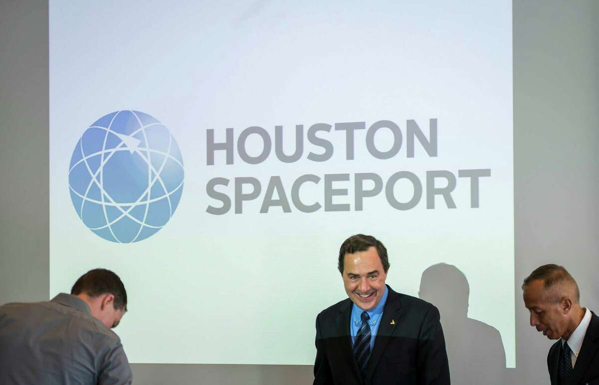 Mark Sirangelo, corporate vice president and head of Sierra Nevada Corporation's Space Systems, center, and Mario Diaz, City of Houston Aviation Director, right, take their seats for a press conference on development of a spaceport at Ellington Airport on Thursday, April 10, 2014, in Houston. The Houston Airport System and Sierra Nevada Corporation hosted a media event on their plans to develop Houston Spaceport as a potential landing site for the Dream Chaser spacecraft. ( Smiley N. Pool / Houston Chronicle )