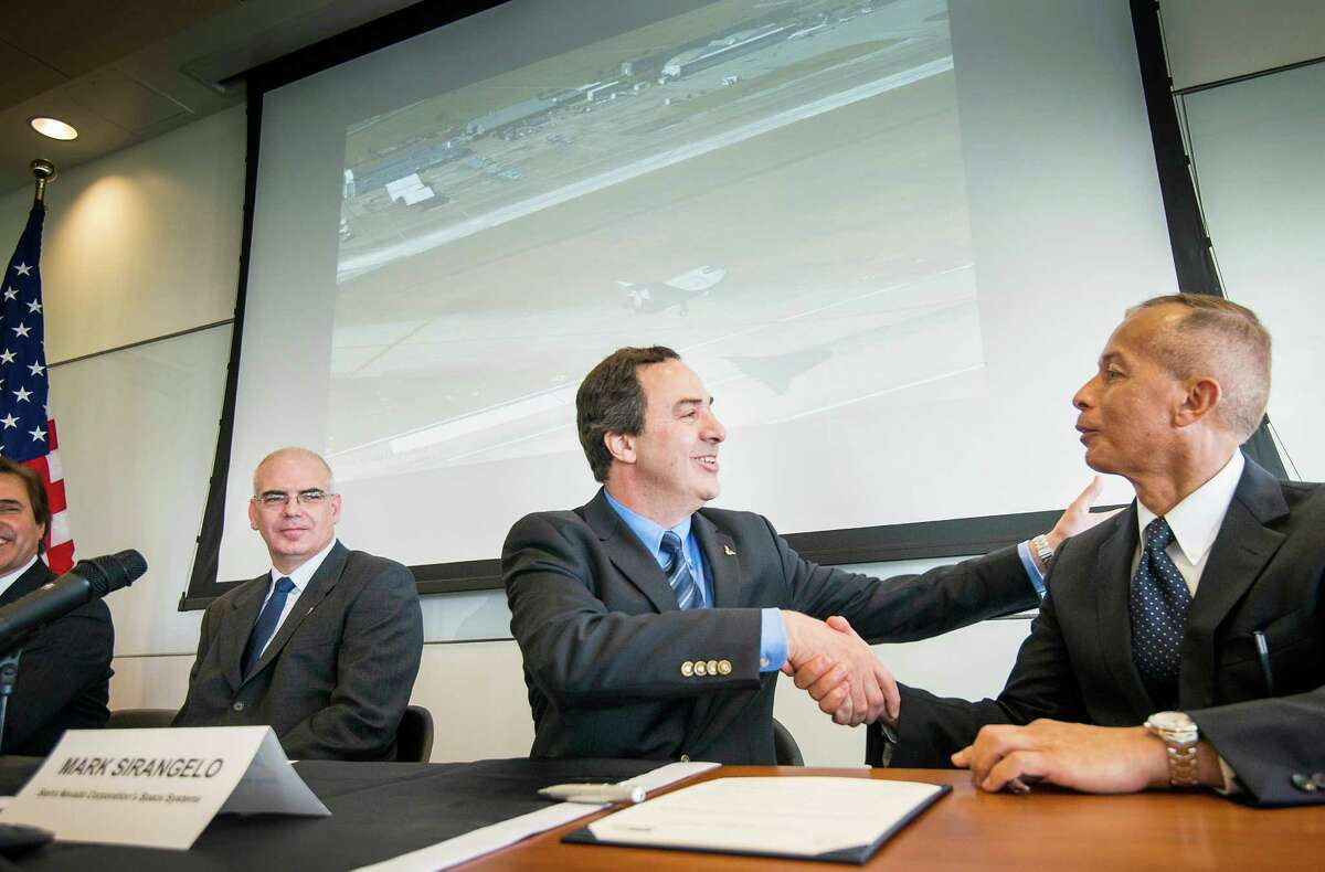 Mark Sirangelo, Sierra Nevada's VP of space systems, signed a deal with Houston Airport System's Mario Diaz