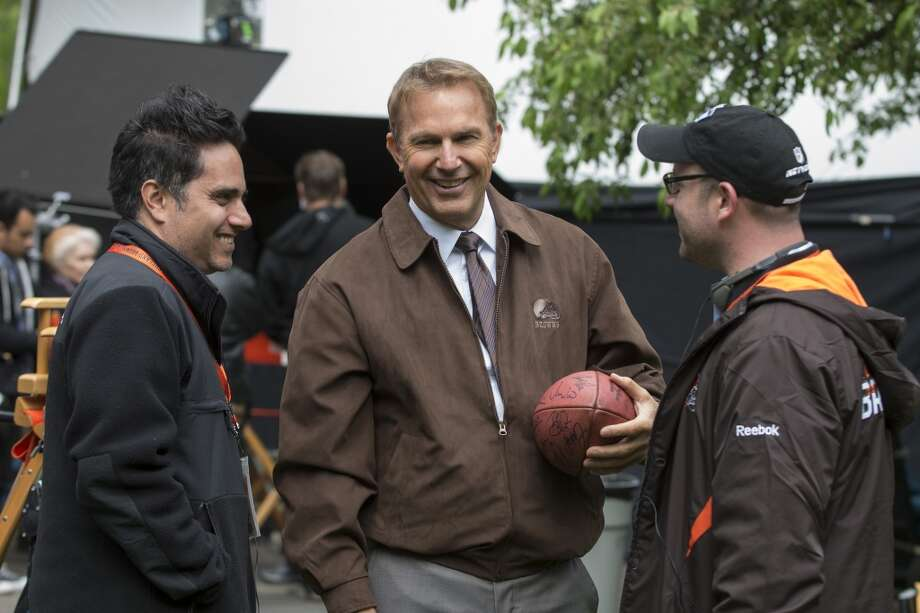 "Rajiv Joseph, left, Kevin Costner, center, and Scott Rothman in a scene from ""Draft Day."" Photo: Dale Robinette, Associated Press"