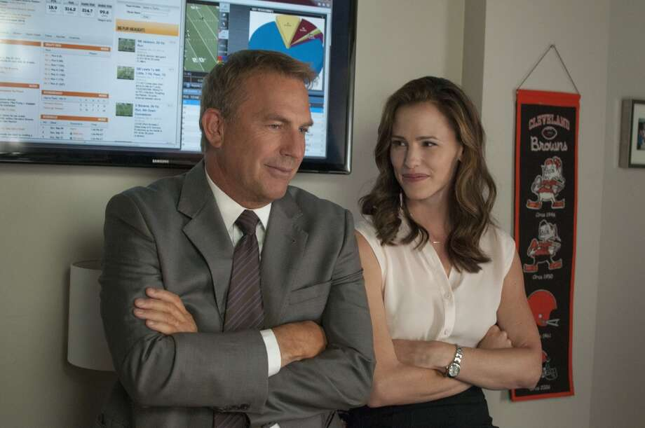 "Kevin Costner, left, and Jennifer Garner in a scene from ""Draft Day."" Photo: Dale Robinette, Associated Press"