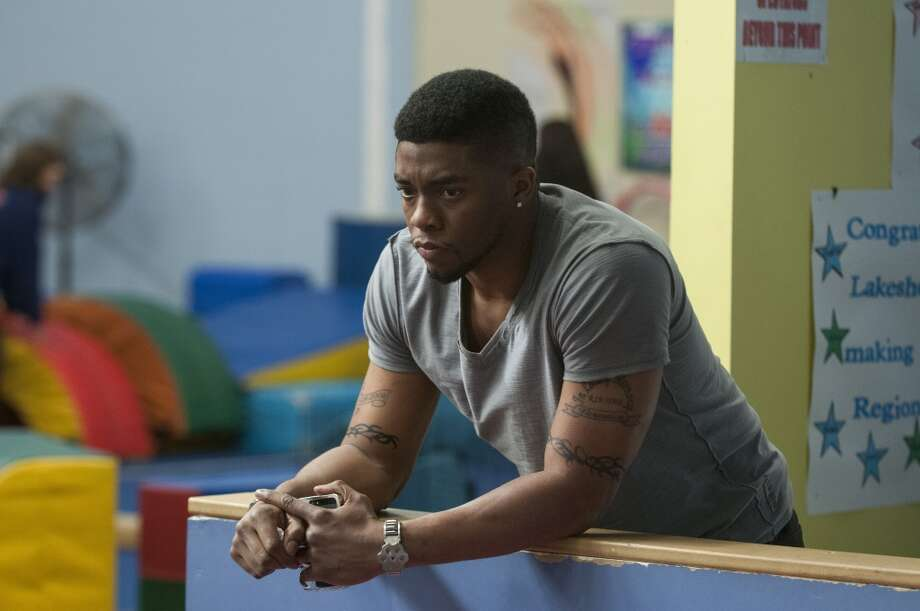 "Chadwick Boseman in a scene from ""Draft Day."" Photo: Dale Robinette, Associated Press"