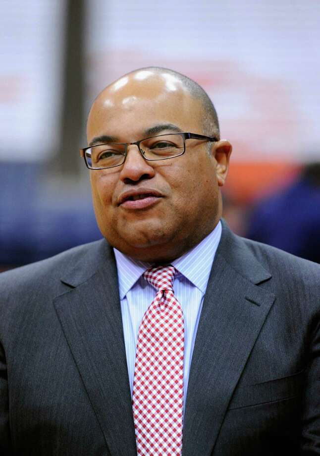 SYRACUSE, NY - DECEMBER 03:  ESPN analyst Mike Tirico looks on prior to the game between the Indiana Hoosiers and the Syracuse Orange at the Carrier Dome on December 3, 2013 in Syracuse, New York.  Syracuse defeated Indiana 69-52.  (Photo by Rich Barnes/Getty Images) Photo: Rich Barnes / 2013 Getty Images