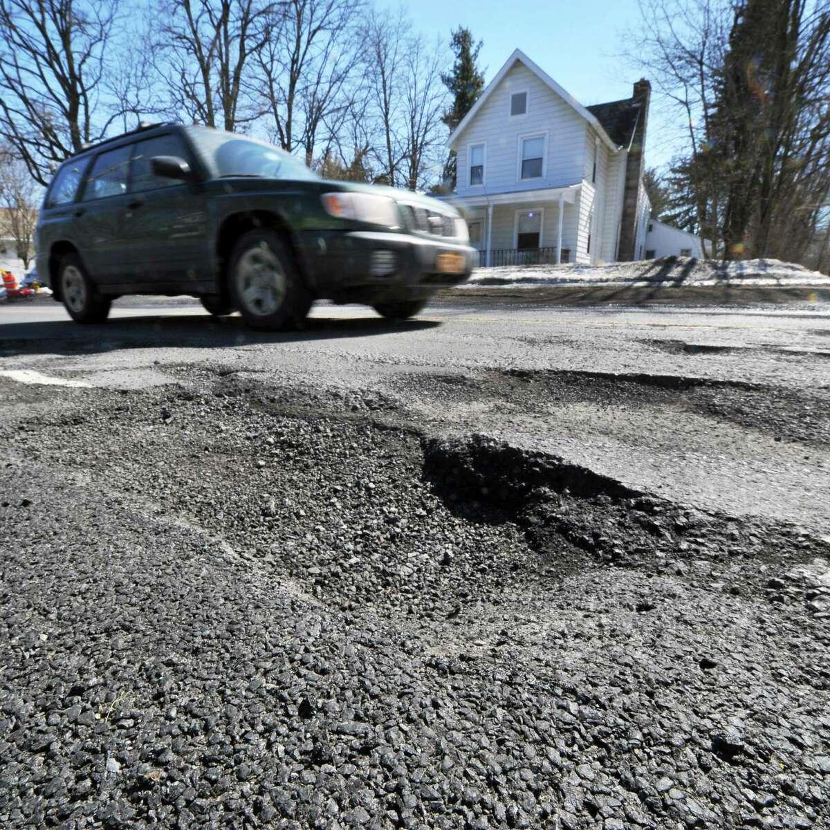 Potholes on Kenwood Avenue near Gardiner Terrace Tuesday March 18, 2014, in Bethlehem, NY. (John Carl D'Annibale / Times Union)
