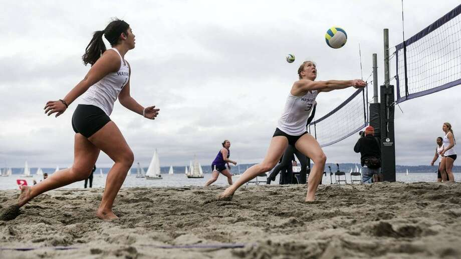 The UW sand volleyball team makes its debut on April 12, 2014. Pictured are players Cassie Strickland, left, and Kaleigh Nelson battling the wind and opponents in the sport's intrasquad opener at Golden Gardens in Seattle on April 5, 2014. Photo: Photo Courtesy UW Athletics / Photo courtesy UW Athletics