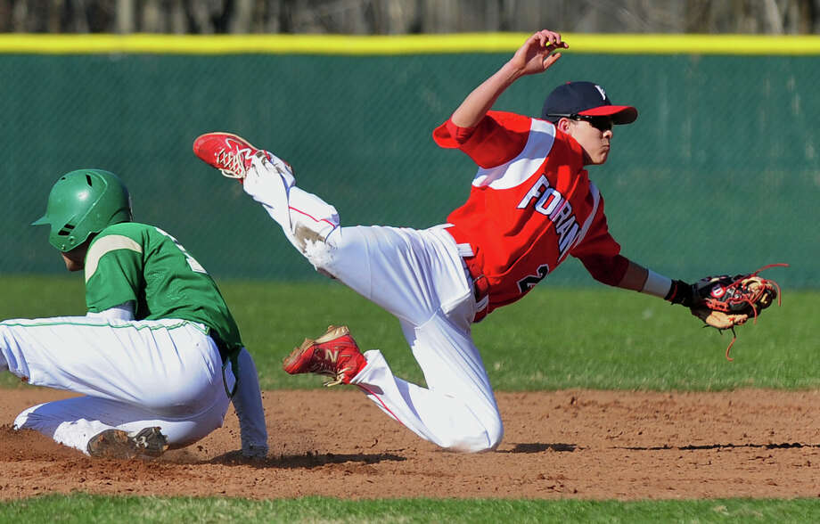 Foran's Robert Lynch falls to the ground after making a catch at second, during baseball action against Notre Dame of West Haven in Milford, Conn. on Thursday April 10, 2014. Notre Dame of West Haven's Andrew Natale got to second safely on a steal. Photo: Christian Abraham / Connecticut Post