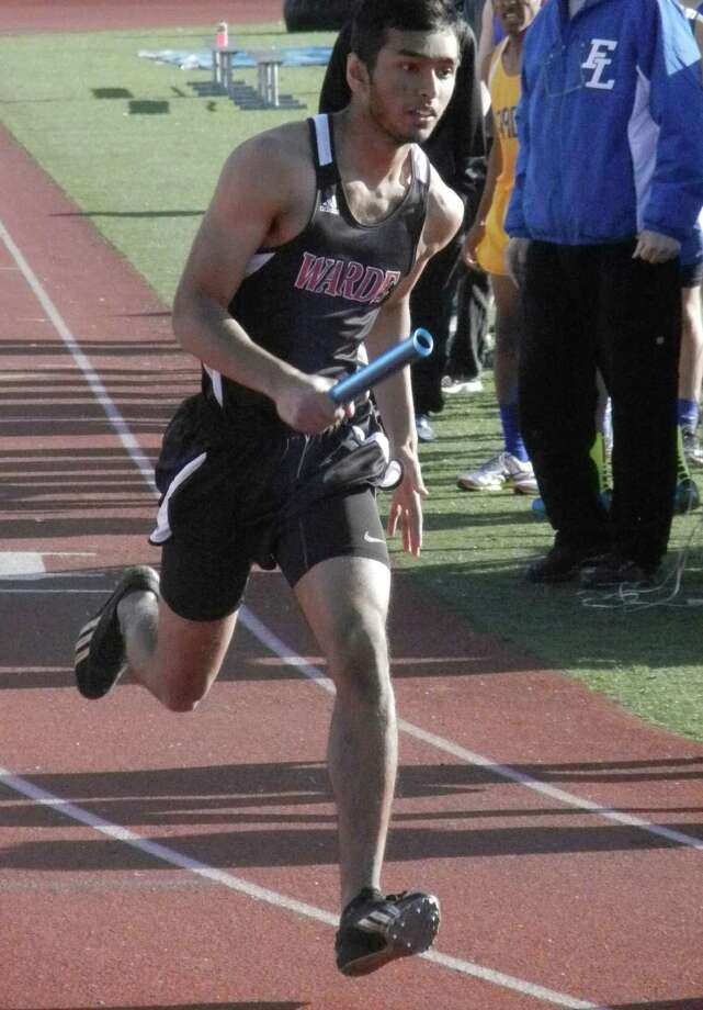 Fairfield Warde senior captain Mohammed Seyal in the 4-by-400-meter relay on Thursday, April 10 in the season-opening FCIAC boys track and field meet at Fairfield Ludlowe with Harding and Bassick. The Mustangs swept all three teams; Ludlowe beat both Bridgeport schools. Seyal set a school record in winning the 400 in 52.04 seconds. He also won the 200. Photo: Reid L. Walmark / Fairfield Citizen