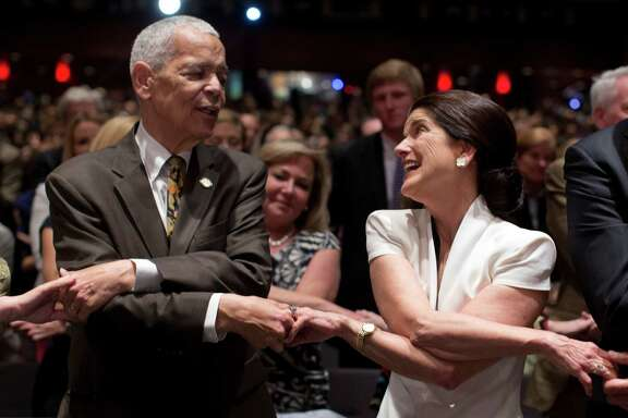 "Civil rights pioneer Julian Bond and Luci Baines Johnson, the younger daughter of LBJ, sing ""We Shall Overcome."""