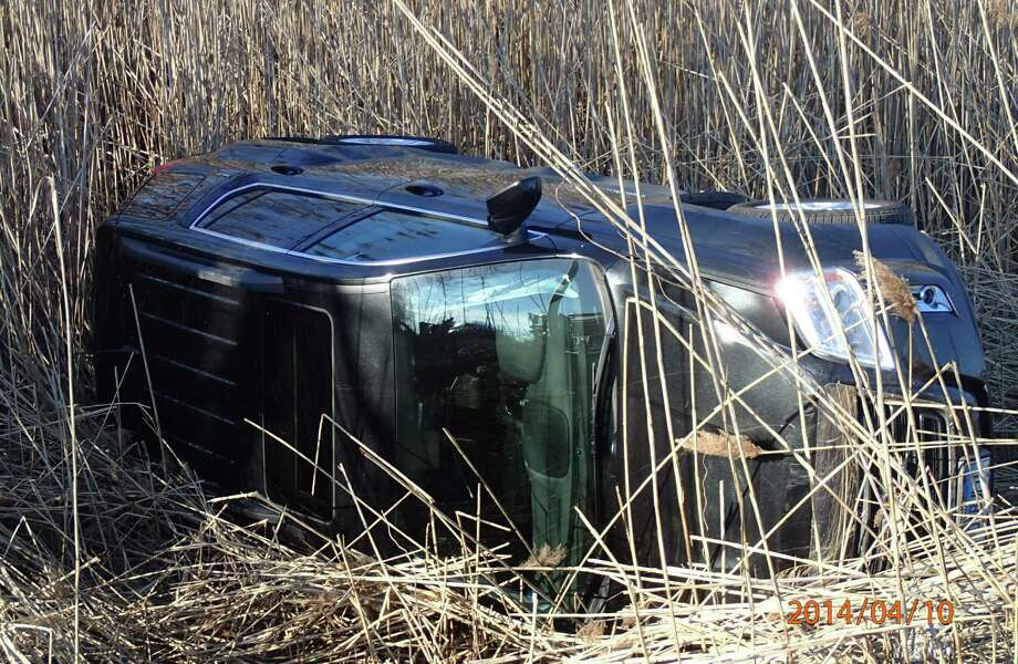 This SUV rolled off Interstate 95 between southbound Exits 18 and 17 Thursday evening, but the vehicle's four occupants escaped serious injuries, according to firefighters. Photo: Westport Fire Department / Westport News