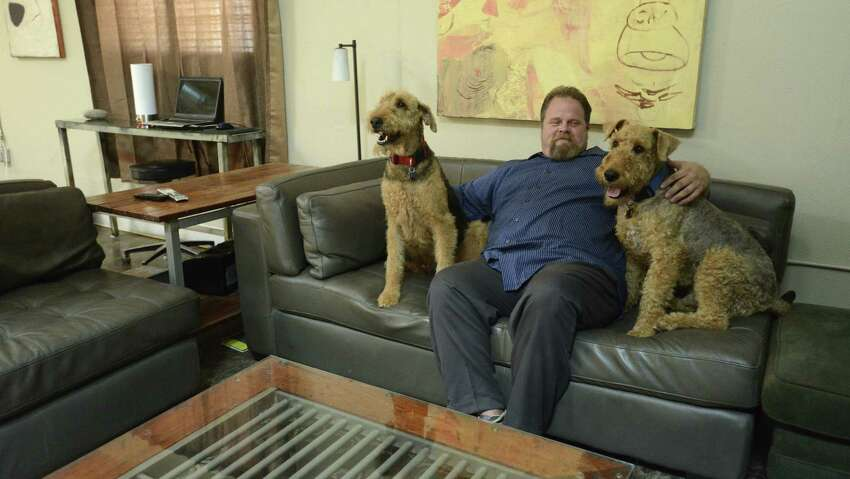 Gordon Wise relaxes with a pair of rescued dogs in his spacious apartment in an old industrial building near the AT&T Center that was once a meat processing plant. Wise was co-owner of the defunct Nightmare on Grayson haunted house near the Pearl.