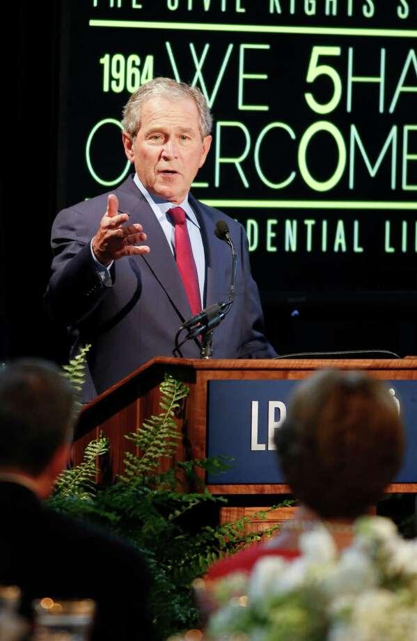 Former President George W. Bush addresses the civil rights summit in Austin on Thursday. Photo: Jack Plunkett, Associated Press / FR59553 AP