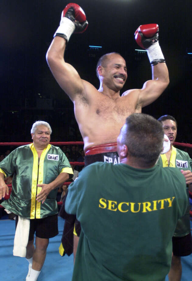 Tony Ayala Sr. (left) trained several world champs, but he was best known for training his four sons. Here, he celebrates Tony Jr.'s victory in his last fight April 15, 2000.  Photo: WILLIAM LUTHER, SAN ANTONIO EXPRESS-NEWS / SAN ANTONIO EXPRESS-NEWS