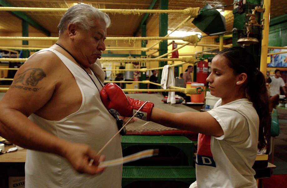 Tony Ayala, Sr. trains Maribel Zurita, 26, for her IFBA Flyweight title defense at the South Zazamora Street Gym Tuesday 26, 2004. Nicole Fruge/San Antonio Express News Photo: NICOLE FRUGE, SAN ANTONIO EXPRESS-NEWS / SAN ANTONIO EXPRESS-NEWS