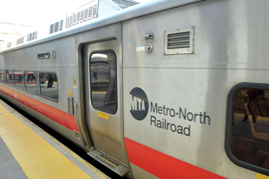 A Metro-North train goes through the Stamford, Conn., train station during rush hour on Thursday, April 10, 2014. Metro-North President Joseph Giulietti paid the station a visit to talk with commuters about their concers for the rail line. Photo: Jason Rearick / Stamford Advocate