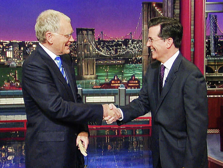 "One guy in glasses replaces another as David Letterman welcomes the choice of Stephen Colbert to replace him as the host of ""Late Night."" Photo: CBS/WORLD WIDE PANTS, HO / CBS/WORLD WIDE PANTS"