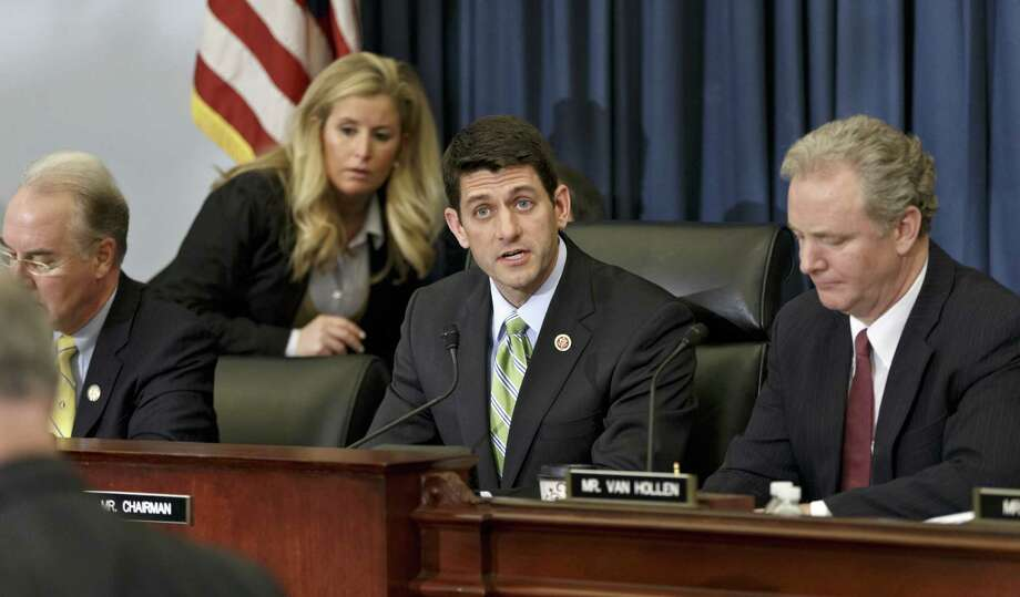 The GOP plan, by Budget Committee Chairman Paul Ryan of Wisconsin (second from right), would sharply cut domestic programs and shift more money to the Pentagon. Photo: J. Scott Applewhite / Associated Press / AP