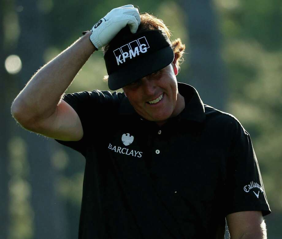 Phil Mickelson had a tough first round at Augusta National, firing a 76, including a 39 on the front nine. He is eight shots behind leader Bill Haas. Photo: Andrew Redington / Getty Images / 2014 Getty Images