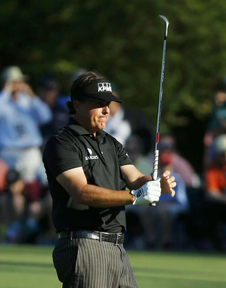Phil Mickelson reacts after his wedge shot on No. 15 trickled into the water. He double-bogeyed the hole. Photo: Mike Blake, Reuters