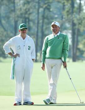 AUGUSTA, GA - APRIL 10:  Fred Couples of the United States waits with his caddie Mark Chaney on the first hole during the first round of the 2014 Masters Tournament at Augusta National Golf Club on April 10, 2014 in Augusta, Georgia.  (Photo by Andrew Redington/Getty Images) Photo: Andrew Redington, Staff / 2014 Getty Images