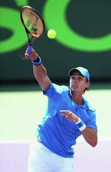 KEY BISCAYNE, FL - MARCH 21:  Alejandro Gonzalez of Columbia serves against   Richard Gasquet of France during their match on day 5 of the Sony Open at Crandon Park Tennis Center on March 21, 2014 in Key Biscayne, Florida.  (Photo by Al Bello/Getty Images) Photo: Al Bello, Staff / 2014 Getty Images