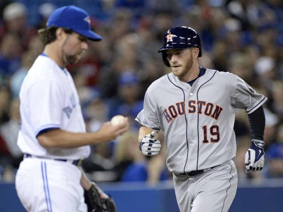Robbie Grossman rounds the bases after his two-run home run as Blue Jays pitcher R.A. Dickey makes his way back to the mound. Photo: Frank Gunn, Associated Press