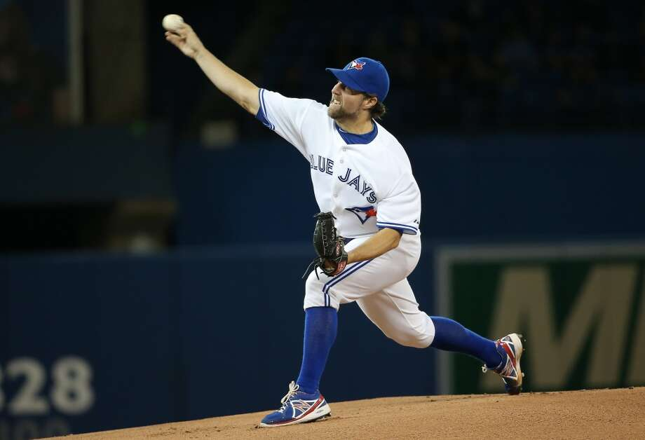 R.A. Dickey delivers a pitch. Photo: Tom Szczerbowski, Getty Images