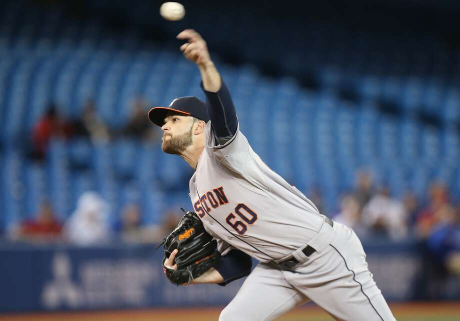 Dallas Keuchel delivers a pitch. Photo: Tom Szczerbowski, Getty Images