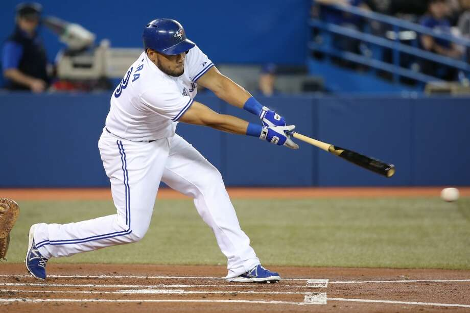 Melky Cabrera of the Blue Jays hits a double. Photo: Tom Szczerbowski, Getty Images