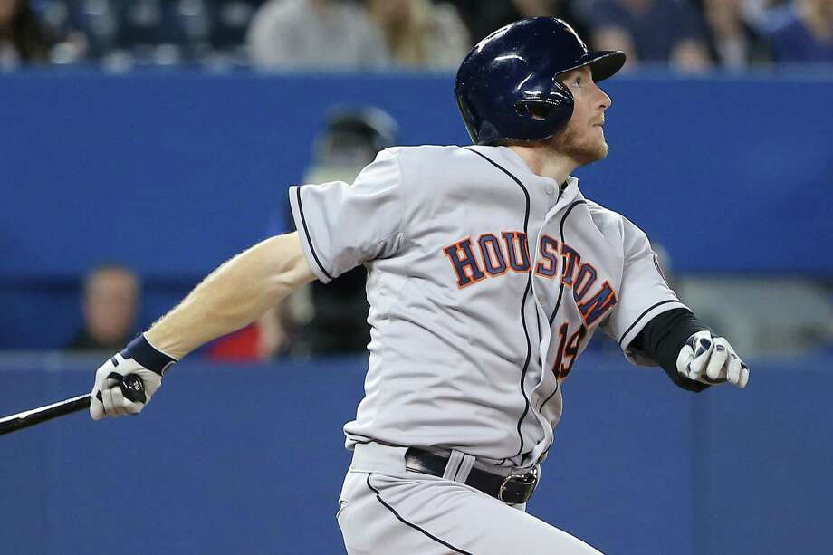 Houston's Robbie Grossman follows through on his two-run homer in the fifth inning against Toronto. Photo: Tom Szczerbowski / Getty Images / 2014 Getty Images