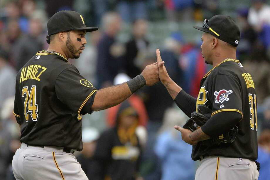The Pirates' Pedro Alvarez (left) and Jose Tabata celebrate their comeback victory at Wrigley Field. Photo: Brian Kersey / Getty Images / 2014 Getty Images