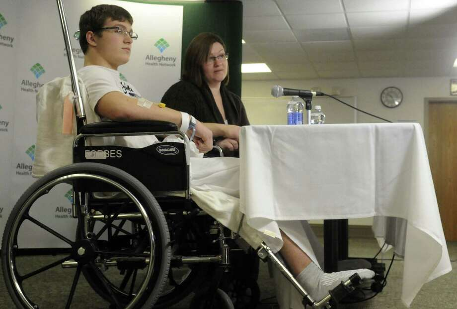 Brett Hurt, 16, recounts being one of those stabbed at Franklin Regional High School in Murrysville, Pa. His mother, Amanda Leonard, accompanied him during the news conference at Forbes Regional Hospital. Photo: Evan Sander / Associated Press / Tribune Review