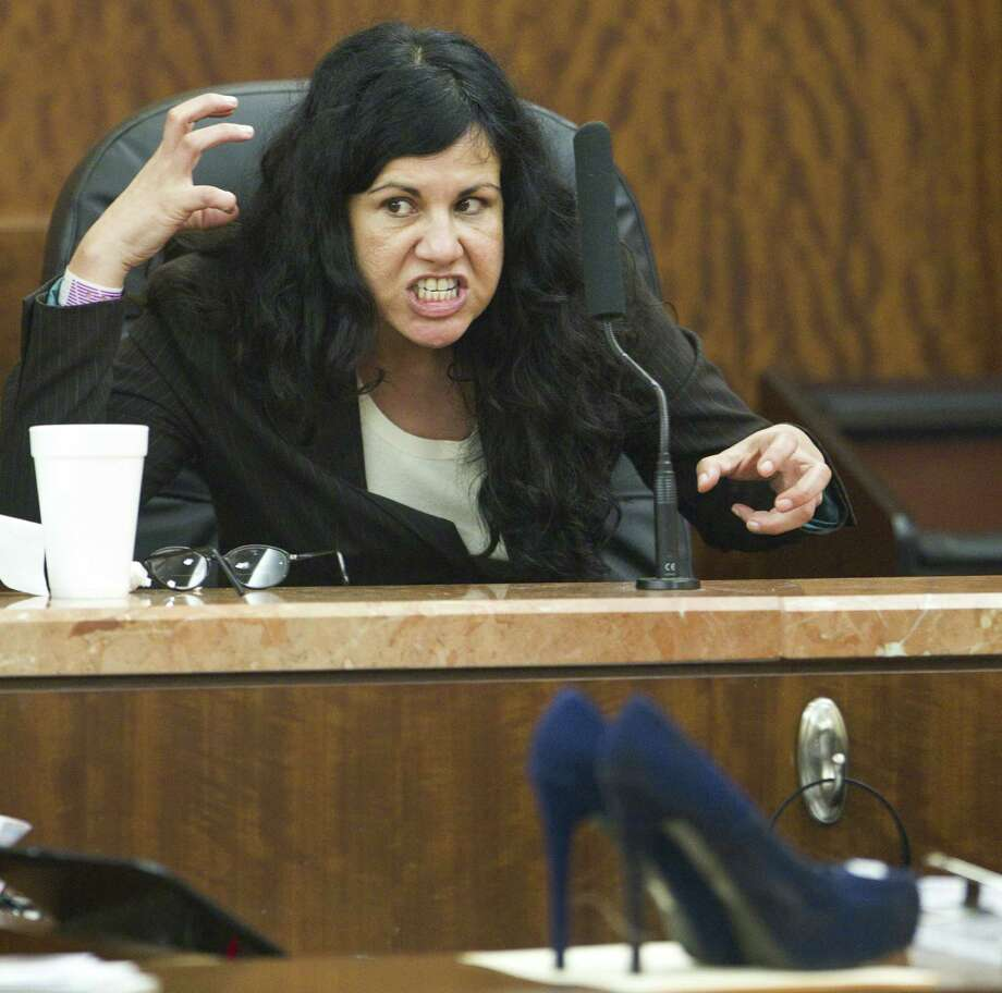 """Ana Trujillo testifies during the punishment phase of her trial, saying she kept striking her boyfriend because, """"He wouldn't let go of my leg. The pain wouldn't stop."""" Photo: Brett Coomer / Houston Chronicle / Houston Chronicle"""