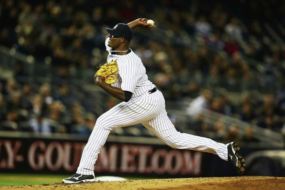 NEW YORK, NY - APRIL 10:  Michael Pineda #35 of the New York Yankees pitches against the Boston Red Sox during their game at Yankee Stadium on April 10, 2014 in the Bronx borough of New York City.  (Photo by Al Bello/Getty Images) ORG XMIT: 477579921 Photo: Al Bello / 2014 Getty Images