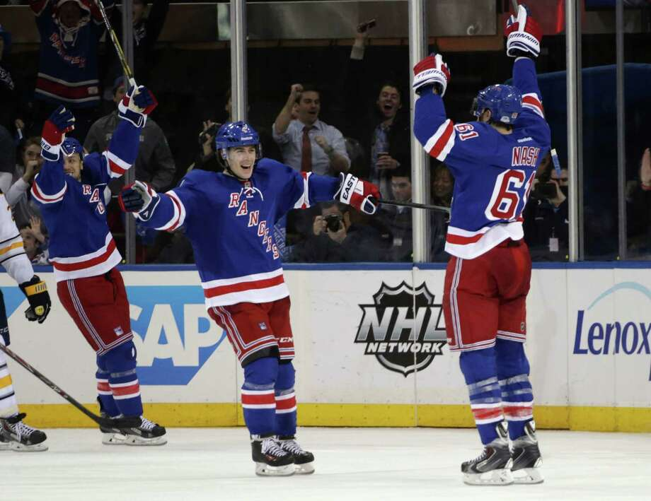 NEW YORK, NY - APRIL 10: Rick Nash #61 of the New York Rangers (R) celebrates his game winning goal at 18:18 of the third period along with Raphael Diaz #4 (L) against the Buffalo Sabres at Madison Square Garden on April 10, 2014 in New York City. The Rangers defeated the Sabres 2-1. (Photo by Bruce Bennett/Getty Images) ORG XMIT: 181116627 Photo: Bruce Bennett / 2014 Getty Images