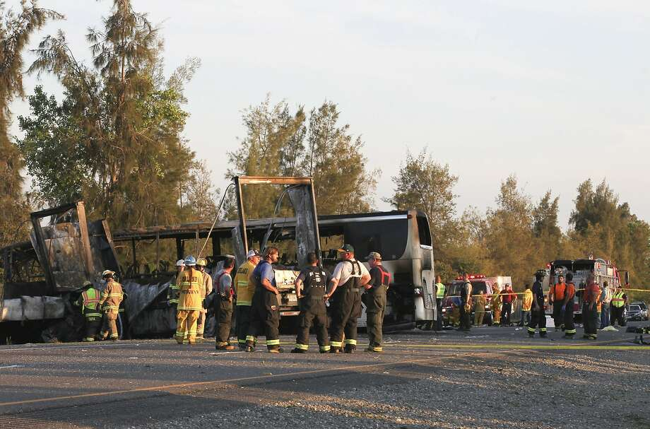 Rescue workers, police and firefighters work the scene on Interstate 5 where nine people were killed in a three-vehicle crash involving a bus carrying high school students, a big rig and a car. Photo: Greg Barnette, Associated Press