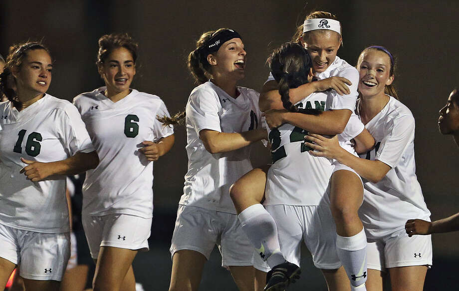 Reagan players congratulate Taylor Olson (being lifted by a teammate) after her game-winning goal with just 26 seconds left edged Steele in Tuesday's 5A regional quarterfinal. Photo: Photos By Tom Reel / San Antonio Express-News