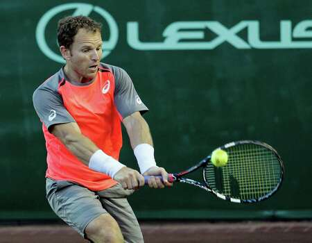 Michael Russell returns against fourth-seeded Nicolas Almagro on Thursday. Almagro, a former top-10 player from Spain, was too skilled on the clay at River Oaks for Russell, winning 6-2, 6-3. Photo: Bob Levey, Photographer / ©2014 Bob Levey
