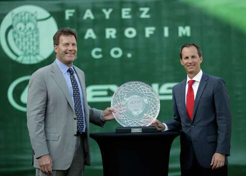 Tournament Director Van Barry, right, and ATP CEO America Mark Young display a crystal signifying the 25th Anniversary of the ATP Thursday, April 10, 2014 at the River Oaks Country Club. (Bob Levey/Special To The Chronicle) Photo: Bob Levey, Houston Chronicle / ©2014 Bob Levey
