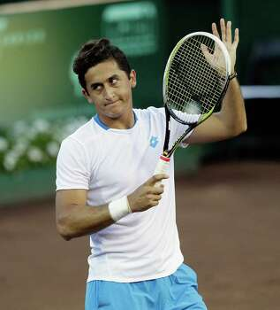 Nicolas Almagro, of Spain, celebrates his win over Michael Russell, 6-2, 6-3 Thursday, April 10, 2014 at the River Oaks Country Club. (Bob Levey/Special To The Chronicle) Photo: Bob Levey, Houston Chronicle / ©2014 Bob Levey
