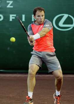 Michael Russell returns a ball against Nicolas Almagro Thursday, April 10, 2014 at the River Oaks Country Club. Almagro defeated Russell 6-2, 6-3. (Bob Levey/Special To The Chronicle) Photo: Bob Levey, Houston Chronicle / ©2014 Bob Levey