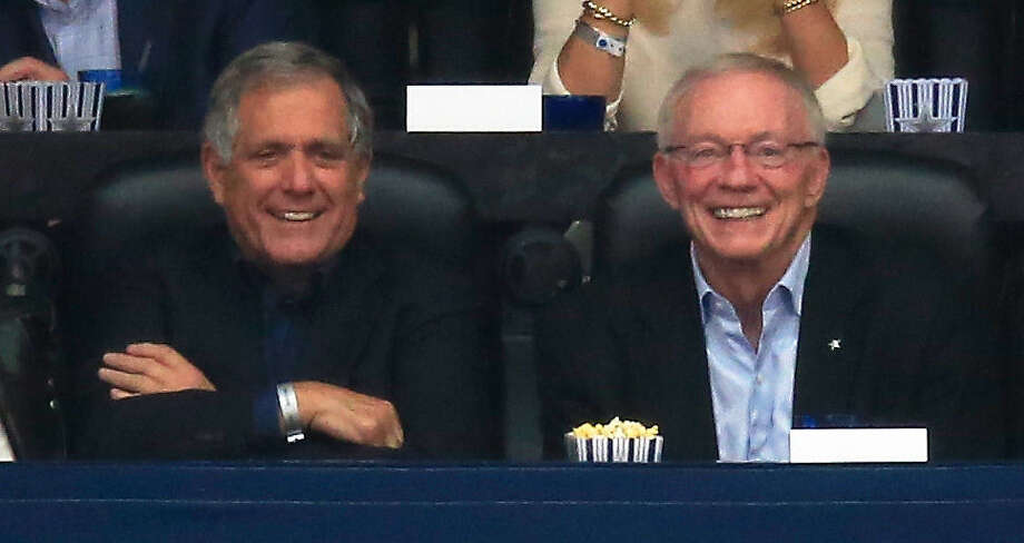 Jerry Jones (right), with CBS CEO Les Moonves, smiles from AT&T Stadium, known as Jerry World. Cowboys fans lately haven't had a lot to smile about. Photo: Jamie Squire / Getty Images / 2014 Getty Images