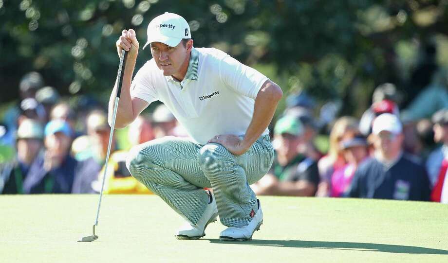 Boerne's Jimmy Walker, lining up a putt on No. 1 at Augusta National, is two shots back after a first-round 2-under 70. Photo: Andrew Redington / Getty Images / 2014 Getty Images