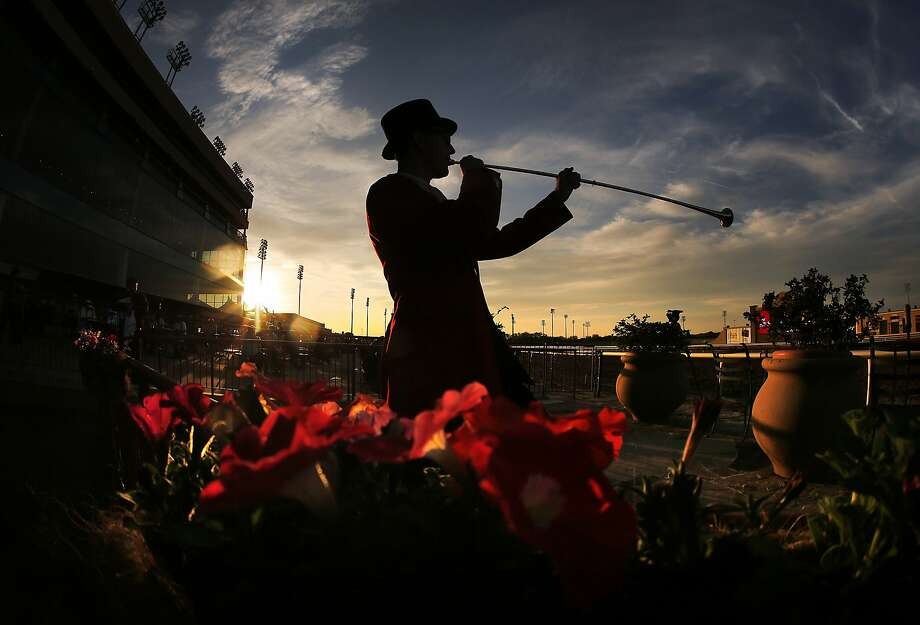 Bugler Jay Elmore., of Dalals, warms up for the Call to the Post between races of the thoroughbred horse racing season-opener at Lone Star Park at Grand Prairie, Texas, on Thursday, April 10, 2014. (AP Photo/The Dallas Morning News, Tom Fox) MANDATORY CREDIT, NO SALES, MAGS OUT, TV OUT, INTERNET USE BY AP MEMBERS ONLY Photo: Tom Fox, Associated Press