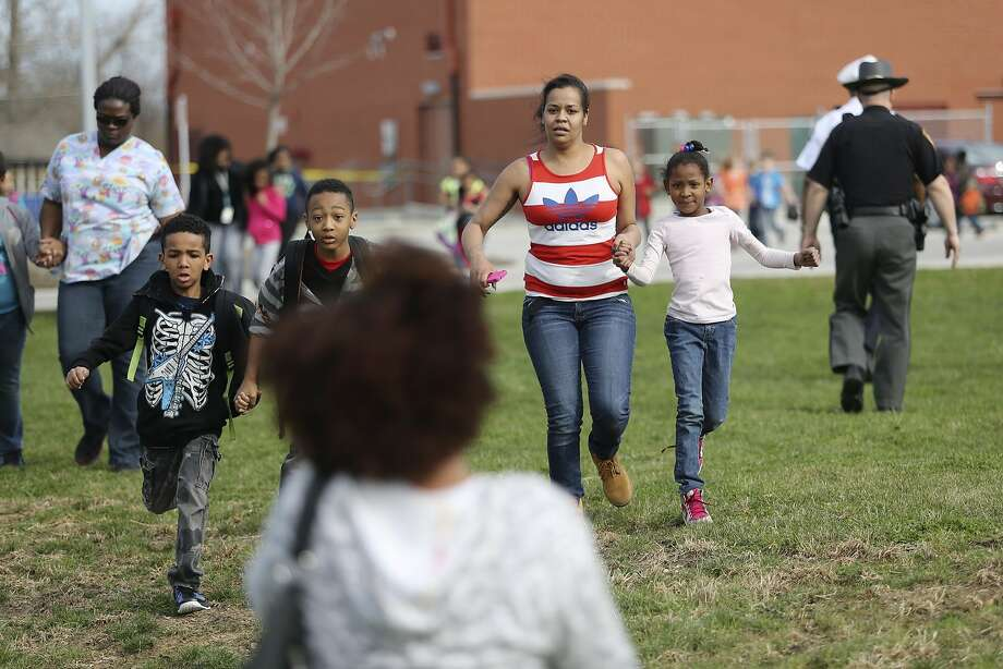 Students and parents are reunited after a lockdown in response to a shooting in the parking lot of Liberty Elementary. The lock down happened just minutes before the students there were to be dismissed, Thursday, April 10, 2014 in Columbus, Ohio. (AP Photo/Columbus Dispatch, Courtney Hergesheimer) Photo: Courtney Hergesheimer, Associated Press