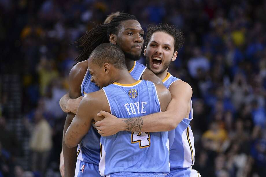 Denver's Kenneth Faried (center) is hugged by teammates after hitting the game-winner. Photo: Kyle Terada, Reuters
