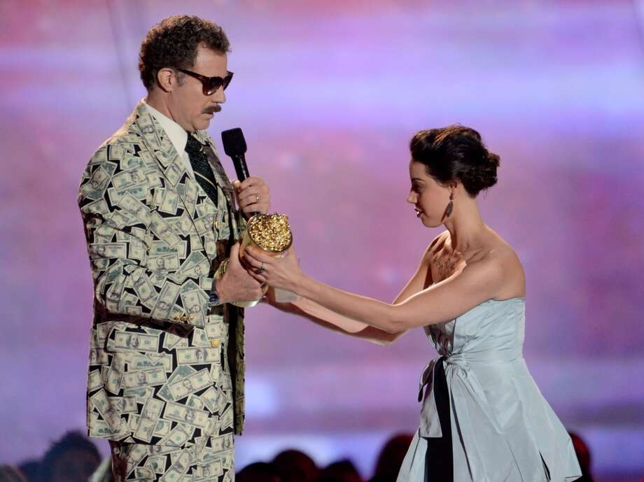 Aubrey Plaza provided an awkward moment at the 2013 MTV Movie Awards when she took to the stage during Will Ferrell's acceptance speech and tried to take his award. Photo: Kevin Mazur, WireImage