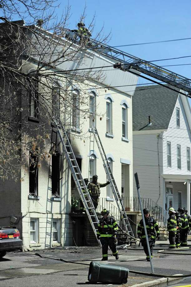 Albany firefighters work at the scene of a house fire on Hunter Ave. on Thursday, April 10, 2014, in Albany, N.Y.   (Paul Buckowski / Times Union) Photo: Paul Buckowski
