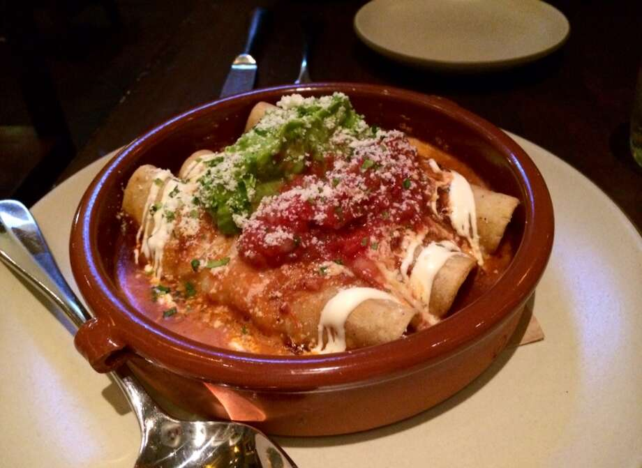 Mamacita: Enchiladas filled with slow-roasted chicken and topped with mole Amarillo ($18)